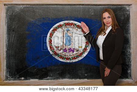 Teacher Showing Flag Ofvirginia On Blackboard For Presentation Marketing And Tourist Advertising