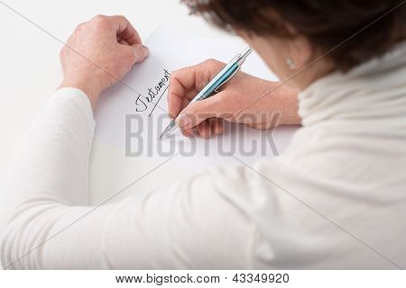 elderly woman writing testament