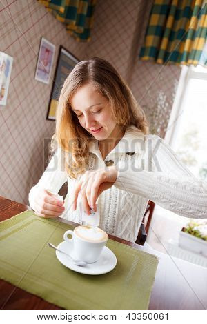 Positive Young Woman With Cup Coffee In Cafe