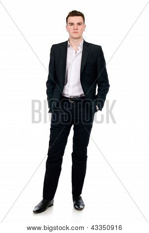 Full Length Of A Handsome Business Man Standing