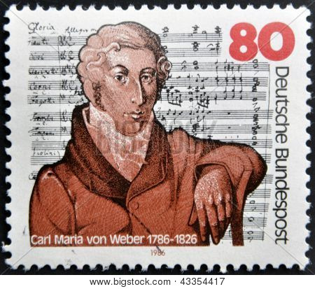 A stamp printed in the Germany shows Carl Maria von Weber on the background Mass in E-flat Major