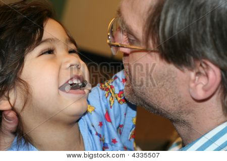 Sick Child Playing With Father In Hospital