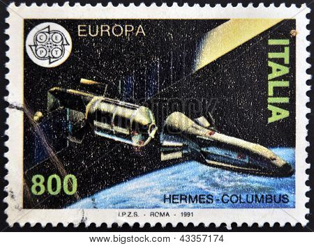 A stamp printed in Italy shows Hermes - Columbus