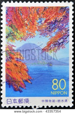 A stamp printed in Japan shows Nantai Volcano Honshu