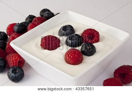 Bowl Of Delicious Berries With Fresh Yogurt