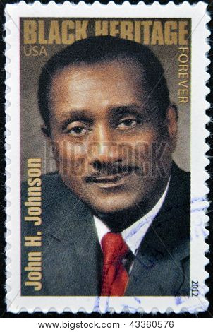 stamp printed in USA shows the portrait of John H. Johnson Black Heritage