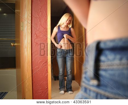 Diet Girl Looking In Mirror At Stomach