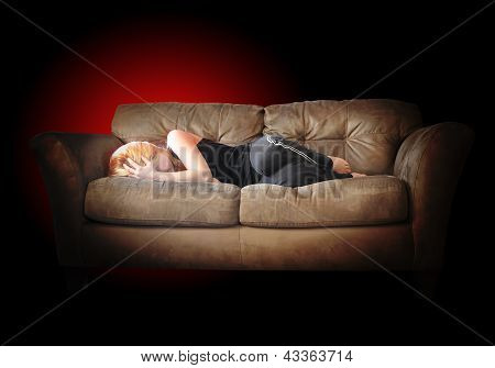 Sad Depressed Girl With Pain On Couch