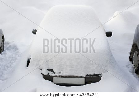 Car covered with fresh snow