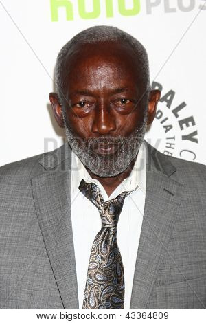 "LOS ANGELES - MAR 14:  Garrett Morris arrives at the  ""2 Broke Girls"" PaleyFEST Event at the Saban Theater on March 14, 2013 in Los Angeles, CA"