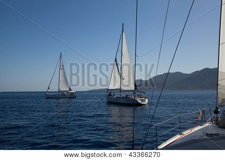 "SARONIC GULF, GREECE - SEPTEMBER 26: Competitors boats during of sailing regatta ""Viva Greece 2012"" on September 26, 2012 on Saronic Gulf, Greece."