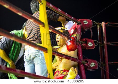 CHANG, THAILAND - FEB 22: Unidentified Muay Thai fighter compete in an amateur kickboxing match, Feb 22, 2013 on Chang, Thailand. Muay Thai practiced over 120000 fans and nearly 10000 professionals.