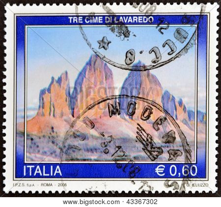 A stamp printed in Italy shows Three Peaks