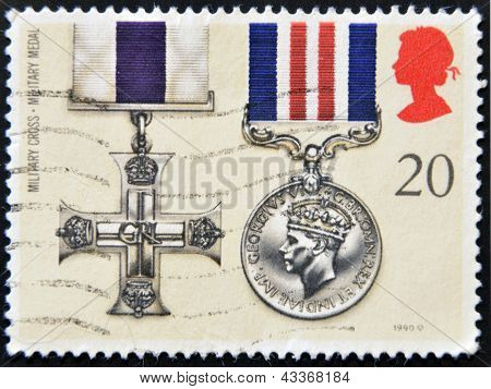 a stamp printed in the Great Britain shows Military Cross Military Medal Gallantry Awards