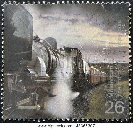 A stamp printed in Great Britain dedicated to millenium shows garratt steam locomotive