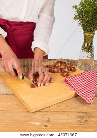 Dried Tomatoes Being Chopped