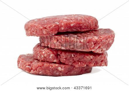 Raw Hamburgers With Transparent Protective Film