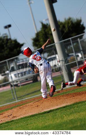Little League Pitcher Throwing To First