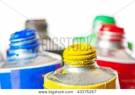Tubes of oil paint open in conjunction