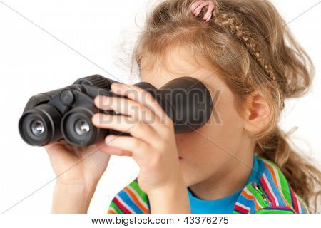 A girl looking through inverted binocular isolated on a white background