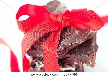 Background Of Stack Of Chocolate With Red Ribbon