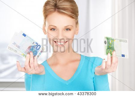 picture of smiling woman with money in hands