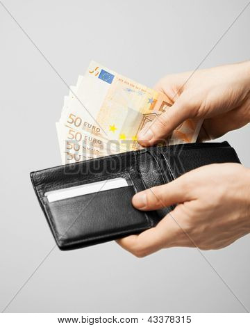 man taking euro cash money out of the wallet