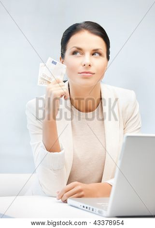picture of smiling businesswoman with cash money