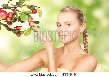 picture of lovely woman with apple twig and butterflies