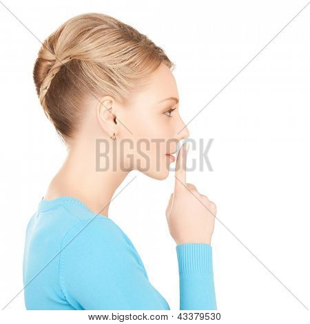picture of mysterious woman with finger on her lips