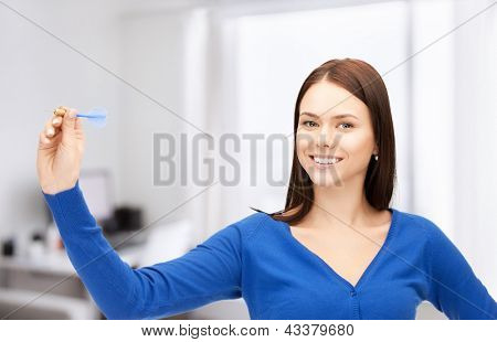 bright picture of confident businesswoman with dart