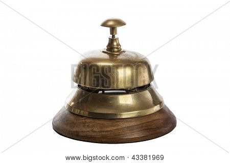 Old brass hotel bell isolated on white