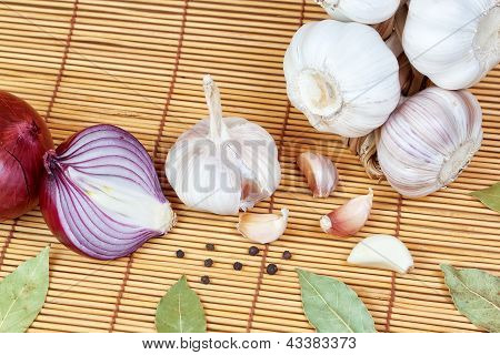 Vegetables, Spices For Cooking Onions, Pepper, Laurel. On A Bamboo Napkin.
