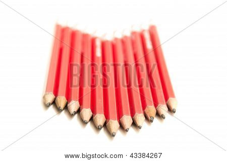 Row Of Red Pencils In An Arrow Shape