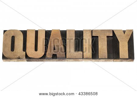 quality - business concept - isolated word in vintage letterpress wood type printing blocks