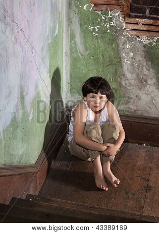 Frightened Boy in White Undershirt and Khaki Pants