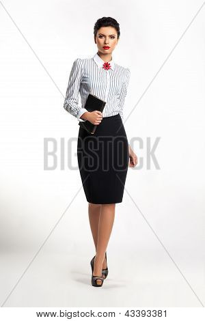 Young Attractive Confident Business Woman With Book Walking