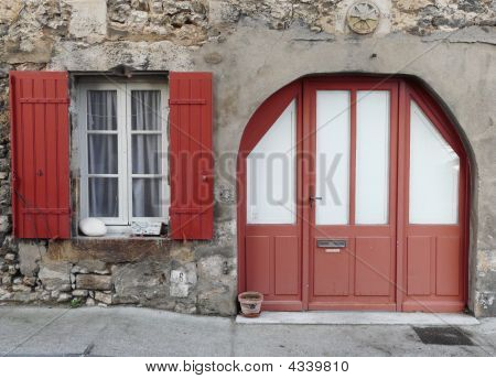 Window With Red Shutters And Doorway