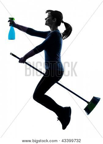 one caucasian woman maid dust cleaning flying broom in silhouette studio isolated on white background