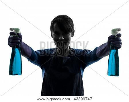 one caucasian woman maid window cleaning sprayer   in silhouette studio isolated on white background