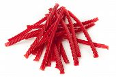 stock photo of licorice  - Bright Red Licorice Candy shaped like a twisted rope - JPG