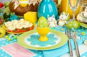 image of laying eggs  - Serving Easter table with tasty dishes close - JPG
