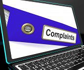 stock photo of moaning  - Complaints File On Laptop Shows Complaints Or Moans Records - JPG