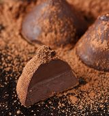 pic of truffle  - Homemade sweet chocolate truffle with cocoa powder.