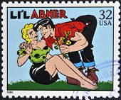 A stamp printed in USA dedicated to comic strip classics shows Lil Abner