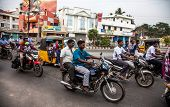 THANJAVUR, INDIA - FEBRUARY 13: Indian riders ride motorbikes on busy road on February 13, 2010 in T