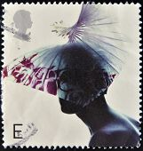 A stamp printed in Great Britain dedicated to fabulous hats, shows Butterfly Hat by Dai Rees