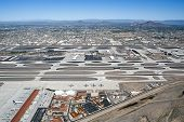 pic of piestewa  - Aerial view of Sky Harbor Airport with Piestewa Peak Camelback Mountain and Four Peaks in the distance - JPG