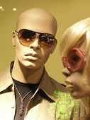 stock photo of skinhead  - mannequins in store with clothes.
