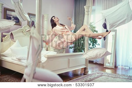Levitating brunette beauty